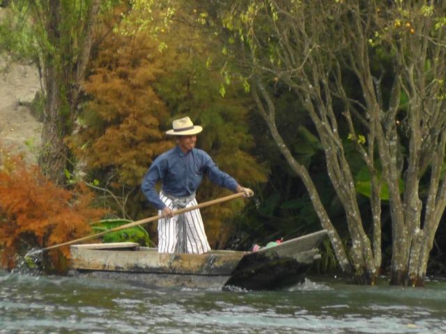 lake atitlan, guatemala, wooden boat, travel, travelogue, ailsa prideaux-mooney
