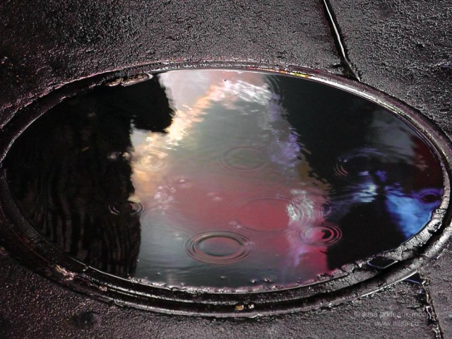 rain water manhole cover new york america us usa reflection neon