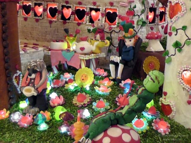 alice wonderland castle gingerbread house village seattle sheraton christmas caterpillar mad hatter